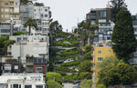 Cars wind their way down Lombard Street in San Francisco, Monday, April 15, 2019. Thousands of tourists may soon have to pay as much as $10 to drive down the world-famous crooked street if a proposal to establish a toll and reservation system becomes law. In the summer months, an estimated 6,000 people a day visit the 600-foot-long street, creating lines of cars that stretch for blocks. (AP Photo/Eric Risberg)