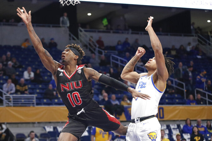 Northern Illinois's Eugene German (10) gets off a shot past Pittsburgh's Au'Diese Toney (5) during the first half of an NCAA college basketball game, Monday, Dec. 16, 2019, in Pittsburgh. Pittsburgh won 59-50. (AP Photo/Keith Srakocic)