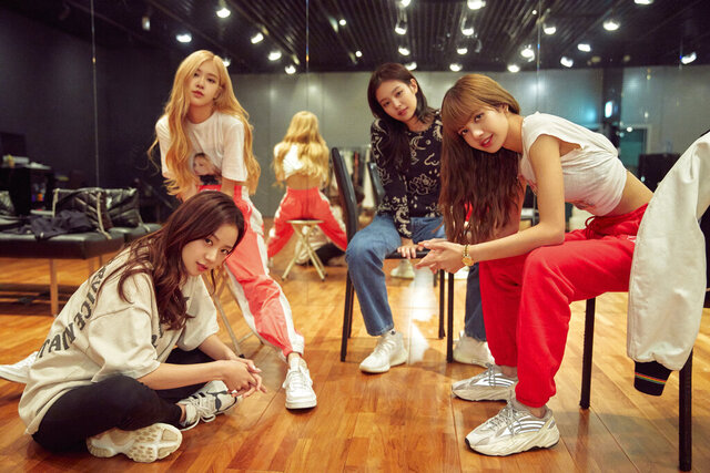 This image released by Netflix shows, from left, Jisoo, seated from left, Rosé, Jennie and Lisa of the K-Pop band Blackpink. The band releases
