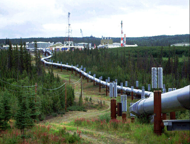 FILE - This undated file photo shows the Trans-Alaska pipeline and pump station north of Fairbanks, Alaska. The future of Alaska's unique program of paying residents an annual check is in question, with oil prices low and an economy struggling during the coronavirus pandemic. (AP Photo/Al Grillo, File)