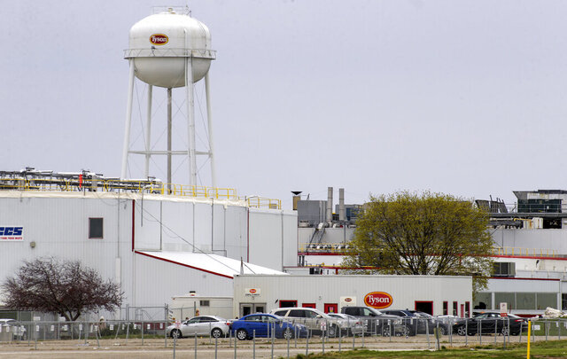 FILE - This April 16, 2020 file photo shows the Tyson Foods pork processing plant in Columbus Junction, Iowa. One of the first coronavirus outbreaks at the Iowa meatpacking plant was more severe than previously known, with over twice as many workers becoming infected than the Iowa Department of Public Health publicly confirmed.  The department announced at a May 5 news conference that 221 employees at the plant in Columbus Junction had tested positive for COVID-19. But records show that, days earlier, Tyson officials told workplace safety regulators that 522 plant employees had tested positive to their knowledge. (Jim Slosiarek/The Gazette via AP, File)
