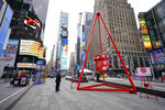 In celebration of Giving Tuesday a giant Salvation Army Red Kettle is seen Tuesday, Dec. 1, 2020, in New York's Times Square. The kettle is in place in various New York City locations during the holiday season. (AP Photo/Mary Altaffer)