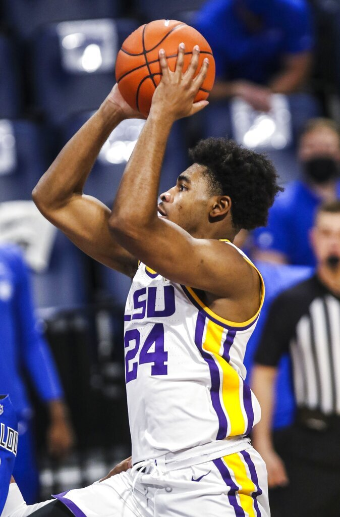 Louisiana State guard Cam Thomas (24) shoots the ball during the first half of an NCAA college basketball game in St. Louis, Mo., Saturday, Nov. 28, 2020.  (Cheyenne Boone/St. Louis Post-Dispatch via AP)