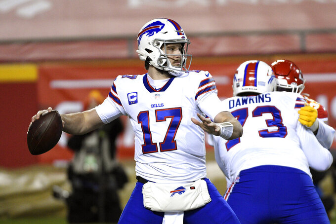 Buffalo Bills quarterback Josh Allen throws a pass during the first half of the AFC championship NFL football game against the Kansas City Chiefs, Sunday, Jan. 24, 2021, in Kansas City, Mo. (AP Photo/Reed Hoffmann)