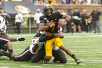 Missouri quarterback Kelly Bryant, top, is sacked by South Carolina's Kingsley Enagbare during the first quarter of an NCAA college football game, Saturday, Sept. 21, 2019, in Columbia, Mo. (AP Photo/L.G. Patterson)