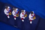 Russian Olympic Committee's artistic gymnastics women's team, Liliia Akhaimova, Viktoriia Listunova, Angelina Melnikova and Vladislava Urazova listen to music from a Russian composer during the medal ceremony after receiving theirs gold medals at the 2020 Summer Olympics, Tuesday, July 27, 2021, in Tokyo. (AP Photo/Morry Gash)