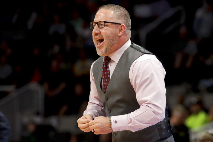 Virginia Tech coach Buzz Williams yells during the first half of the team's second-round game against Liberty in the NCAA men's college basketball tournament Sunday, March 24, 2019, in San Jose, Calif. (AP Photo/Jeff Chiu)