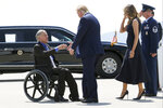 FILE - In this Aug. 7, 2019 file photo, President Donald Trump and Melania Trump greet Texas Gov. Greg Abbott after arriving in El Paso, Texas. Abbott says the state will reject the re-settlement of new refugees, becoming the first state known to do so under a recent Trump administration order. In a letter released Friday, Jan, 10, 2020, Abbott wrote that Texas