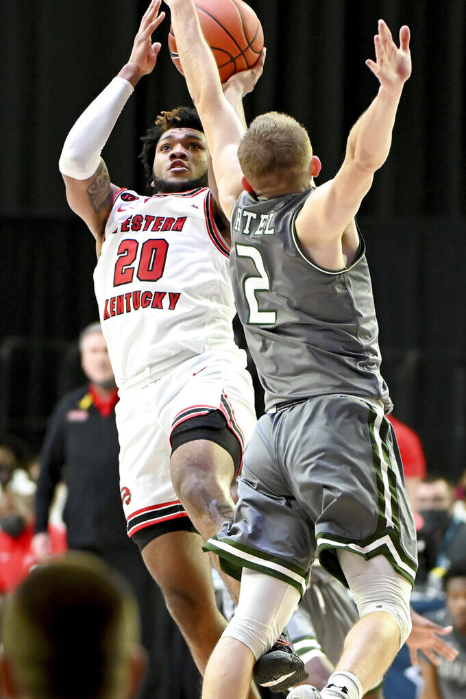 Western Kentucky guard Dayvion McKnight (20) shoots over UAB guard Michael Ertel (2) in the first half of an NCAA college basketball game in the Conference USA men's tournament, in Frisco, Texas, Friday, March 12, 2021. (AP Photo/Matt Strasen)