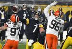 Pittsburgh Steelers quarterback Ben Roethlisberger (7) throws a pass during the first half of an NFL wild-card playoff football game against the Cleveland Browns in Pittsburgh, Sunday, Jan. 10, 2021. (AP Photo/Don Wright)