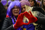 Female demonstrators wear ed glove as as symbol against male violence as they march during the International Women's Day in Pamplona, northern Spain, Friday, March 8, 2019. Spanish women are marking International Women's Day with a full day strike and dozens of protests across the country against wage gap and gender violence. (Alvaro Barrientos)