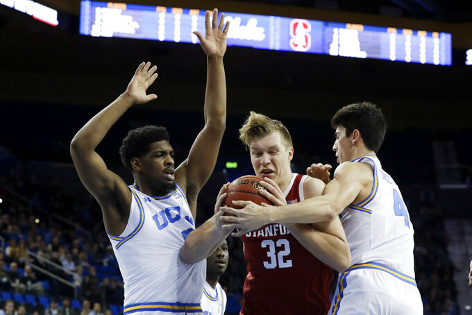 Stanford forward Lukas Kisunas drives the the basket between UCLA forward Cody Riley, left, and guard Jaime Jaquez Jr. during the first half of an NCAA college basketball game in Los Angeles, Wednesday, Jan. 15, 2020. (AP Photo/Chris Carlson)