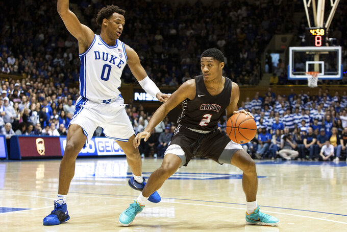 Brown's Brandon Anderson (2) handles the ball as Duke's Wendell Moore Jr. (0) defends during the first half of an NCAA college basketball game in Durham, N.C., ;Saturday, Dec. 28, 2019. (AP Photo/Ben McKeown)