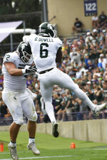 Michigan State defensive tackle Mike Panasiuk (72) and safety David Dowell (6) celebrate a defensive stop against Northwestern during the first half of an NCAA college football game, Saturday, Sept. 21, 2019, in Evanston, Ill. (AP Photo/David Banks)