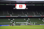 FILE - This June 3, 2020, file photo shows empty stands during the German Bundesliga soccer match between SV Werder Bremen and Eintracht Frankfurt in Bremen, Germany. Many professional sports league, such as the NFL and European soccer leagues, have lucrative television contracts and big-money corporate sponsors that fill their substantial coffers. But the domestic soccer league in the U.S. still relies heavily on ticket sales, merchandising and concessions, much like many university athletic departments, and without games their very ability to make ends meet would stretch the abilities of even the savviest of accountants. (Stuart Franklin/Pool via AP, File)