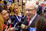 Warren Buffett, Chairman and CEO of Berkshire Hathaway, speaks to reporters during a tour of the CHI Health convention center where various Berkshire Hathaway companies display their products, before presiding over the annual shareholders meeting in Omaha, Neb., Saturday, May 4, 2019. An estimated 40,000 people are expected in town for the event, where Buffett and his Vice Chairman Charlie Munger will preside over the meeting and spend hours answering questions. (AP Photo/Nati Harnik)