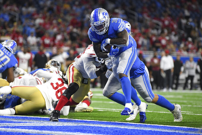 Detroit Lions running back Jamaal Williams (30) runs for a one-yard touchdown against the San Francisco 49ers in the second half of an NFL football game in Detroit, Sunday, Sept. 12, 2021. (AP Photo/Lon Horwedel)