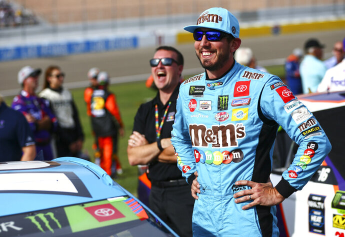 FILE - In this Sunday, Sept. 15, 2019, file photo ,Kyle Busch prepares for a NASCAR Cup Series auto race at Las Vegas Motor Speedway in Las Vegas, Nev. The NASCAR playoffs didn't start the way Busch wanted, with him relegated to a middle-of-the-pack finish at Las Vegas that dropped him to fourth in the championship race. Now, though, the series arrives at Richmond Raceway, where no one else in the field can touch his six career victories. (AP Photo/Chase Stevens, File)