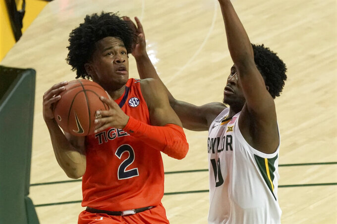 Auburn's Sharife Cooper, left, drives against Baylor's Adam Flagler, right, during the first half of an NCAA college basketball game in Waco, Texas, Saturday, Jan. 30, 2021. (AP Photo/Chuck Burton)
