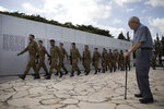 Israeli honor guards march in formation during rehearsal just before a ceremony marking the annual Memorial Day to remember fallen soldiers and victims of terror, at the Armored Corps memorial site in Latrun, Israel, Wednesday, May 8, 2019. Israel marks the annual Memorial Day in remembrance of soldiers who died in the nation's conflicts. (AP Photo/Oded Balilty)