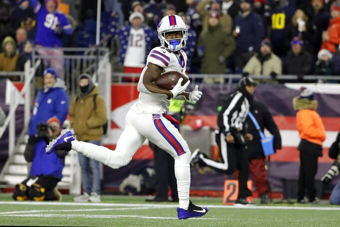 Buffalo Bills wide receiver John Brown runs for a touchdown after catching a pass in the second half of an NFL football game against the New England Patriots, Saturday, Dec. 21, 2019, in Foxborough, Mass. (AP Photo/Steven Senne)