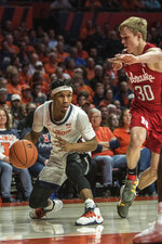 Illinois' Trent Frazier (1) maneuvers around Nebraska's Charlie Easley (30) in the first half of an NCAA college basketball game Monday, Feb. 24, 2020, in Champaign, Ill. (AP Photo/Holly Hart)