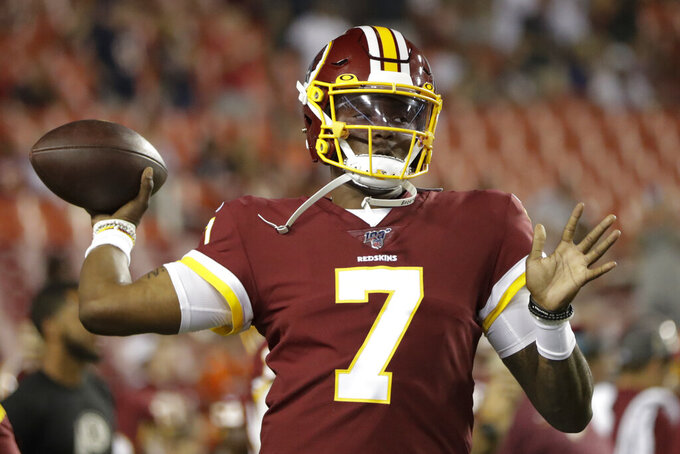 FILE - In this Monday, Sept. 23, 2019 file photo, Washington Redskins quarterback Dwayne Haskins throws before an NFL football game against the Chicago Bears in Landover, Md. Case Keenum's foot injury could put him in danger of starting at quarterback for the Washington Redskins on Sunday, Sept. 29, 2019 at the New York Giants. If Keenum can't play, the 0-3 Redskins will either turn to Colt McCoy or ask first-round pick Dwayne Haskins to make his NFL debut.(AP Photo/Julio Cortez, File)