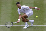 Serbia's Novak Djokovic returns the ball to Belgium's David Goffin during a men's quarterfinal match on day nine of the Wimbledon Tennis Championships in London, Wednesday, July 10, 2019. (AP Photo/Kirsty Wigglesworth)