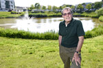 Former Navy frogman Clancy Hatleberg, who was the first person to interact with the Apollo 11 crew when they returned to earth from the moon on July 24, 1969, stands near a pond outside his home Friday, July 11, 2019 in Laurel, Md. He was 25 at the time of the historic mission, and fresh from an underwater demolition team rotation in Vietnam. (AP Photo/Steve Ruark)