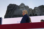 President Donald Trump watches as planes perform fly-overs of the Mount Rushmore National Monument Friday, July 3, 2020, in Keystone, S.D. (AP Photo/Alex Brandon)