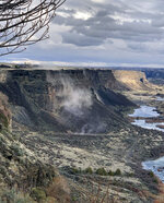 In a photo provided by Israel Bravo, rocks fall from the north side of the Snake River Canyon during an earthquake, Tuesday, March 31, 2020, near Twin Falls, Idaho. A large earthquake struck north of Boise on Tuesday evening, with people across a large area reporting shaking. (Israel Bravo via AP)