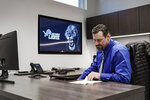 In this image provided by the Detroit Lions, Detroit Lions head coach Dan Campbell sits in his office on his first day at the NFL football team's practice facility, Thursday, Jan. 21, 2021 in Allen Park, Mich. (Detroit Lions via AP).