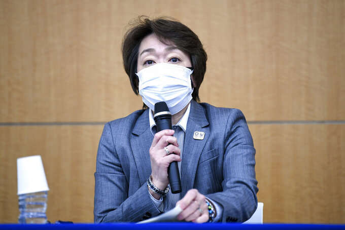 """Seiko Hashimoto, president of the Tokyo 2020 Organizing Committee of the Olympic and Paralympic Games, speaks during a press conference regarding its creative director's comments about a well-known female celebrity, in Tokyo Thursday, March 18, 2021. Tokyo Olympics creative director Hiroshi Sasaki is resigning after making demeaning the comments. Sasaki was in charge of the opening and closing ceremonies for the Olympics, which are to begin on July 23. Last year he told planning staff members that well-known entertainer Naomi Watanabe could perform in the ceremony as an """"Olympig."""" (Kazuhiro Nogi/Pool Photo via AP)"""