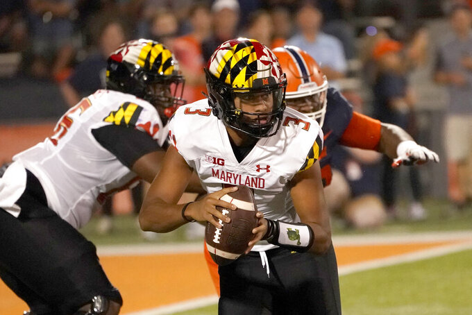 Maryland quarterback Taulia Tagovailoa scrambles away from pressure by Illinois during the first half of an NCAA college football game Friday, Sept. 17, 2021, in Champaign, Ill. (AP Photo/Charles Rex Arbogast)