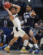 Purdue's Carsen Edwards (3) is guarded by Villanova's Phil Booth (5) during the first half of a second round men's college basketball game in the NCAA tournament, Saturday, March 23, 2019, in Hartford, Conn. (AP Photo/Jessica Hill)