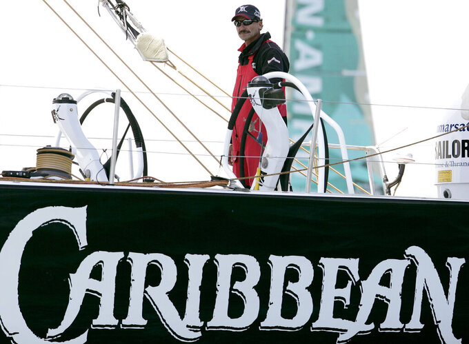 FILE - In this April 29, 2006, file photo Paul Cayard, skipper of the Pirates of the Caribbean Volvo Ocean Race boat steers his boat as they team readies for the start of the Baltimore in Port race on the Chesapeake Bay. Cayard has raced in the America's Cup, the Olympics and was the first American skipper to win one of sailing's toughest challenges, the Whitbread Round the World Race. Now he faces another arduous task, guiding the underperforming U.S. Olympic sailing team as its new executive director. (AP Photo/Chris Gardner, File)