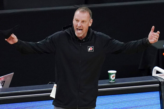 Utah head coach Larry Krystkowiak reacts during the first half of an NCAA college basketball game against Southern California in the quarterfinal round of the Pac-12 men's tournament Thursday, March 11, 2021, in Las Vegas. (AP Photo/John Locher)