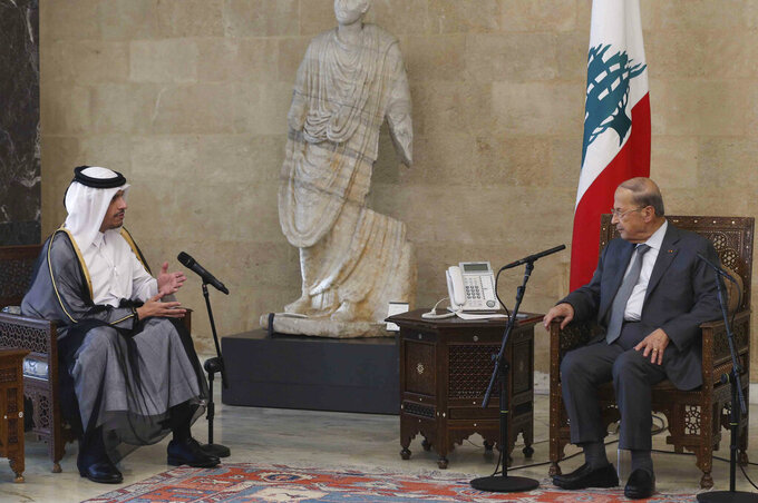In this photo released by Lebanon's official government photographer Dalati Nohra, Lebanese president Michel Aoun, right, meets with Qatar's Deputy Prime Minister and Foreign Minister Sheikh Mohammed bin Abdulrahman bin Jassim Al-Thani, at the presidential palace, in Baabda, east of Beirut, Lebanon, Tuesday, July 6, 2021. Qatar's Foreign Minster is in Beirut for one day visit to meet with Lebanese officials and the Lebanese Army Commander Gen. Joseph Aoun. (Lebanon Government  /Dalati Nohra via AP)