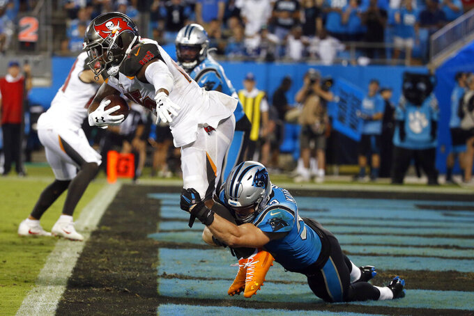 Carolina Panthers middle linebacker Luke Kuechly (59) tackles Tampa Bay Buccaneers running back Peyton Barber (25) for a safety during the second half of an NFL football game in Charlotte, N.C., Thursday, Sept. 12, 2019. (AP Photo/Brian Blanco)