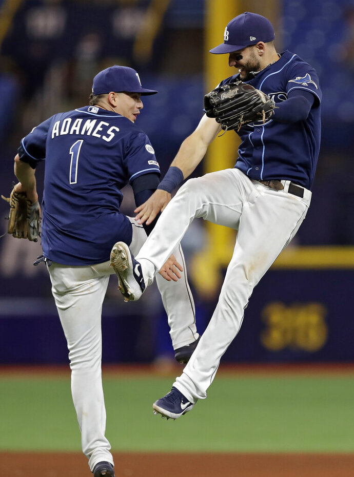 Tampa Bay Rays center fielder Kevin Kiermaier, right, and shortstop Willy Adames celebrate after they defeated the Boston Red Sox during a baseball game Monday, Sept. 23, 2019, in St. Petersburg, Fla. (AP Photo/Chris O'Meara)
