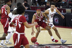 Arkansas guard Moses Moody (5) dribbles next to South Carolina forward Justin Minaya (10) during the second half of an NCAA college basketball game Tuesday, March 2, 2021, in Columbia, S.C. (AP Photo/Sean Rayford)