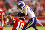 Minnesota Vikings safety Harrison Smith (22) breaks up a pass intended for Kansas City Chiefs wide receiver Tyreek Hill (10) during the first half of an NFL football game in Kansas City, Mo., Sunday, Nov. 3, 2019. (AP Photo/Colin E. Braley)