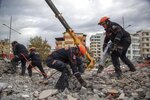 Turkish rescuers search at a collapsed building in Durres, western Albania, Thursday, Nov. 28, 2019. Hopes were fading Thursday of finding anyone else alive beneath the rubble of collapsed buildings in Albania two days after a deadly quake struck the country's Adriatic coast, with the death toll increasing to 40 after more bodies were pulled from the ruins. (AP Photo/Visar Kryeziu)
