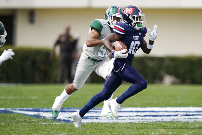 Jackson State punt return specialist Newman Warren (10) runs away from a Mississippi Valley State defender for a long punt return during the first half of an NCAA college football game, Sunday, March 14, 2021, in Jackson, Miss. (AP Photo/Rogelio V. Solis)