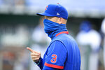 Chicago Cubs manager David Ross signals for a new pitcher during the third inning of a baseball game against the Kansas City Royals at Kauffman Stadium in Kansas City, Mo., Thursday, Aug. 6, 2020. (AP Photo/Orlin Wagner)