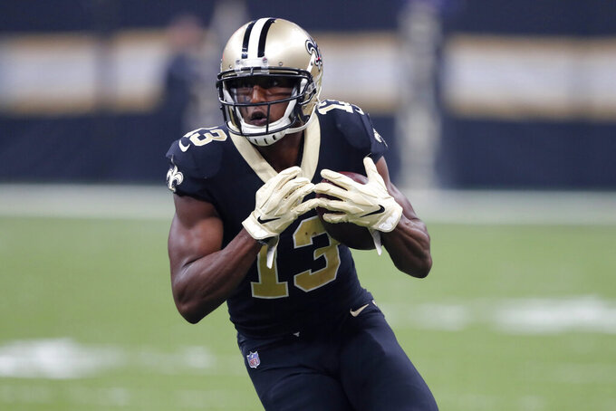 New Orleans Saints wide receiver Michael Thomas (13) carries on a a reception in the first half of an NFL football game in New Orleans, Monday, Sept. 9, 2019. (AP Photo/Bill Feig)