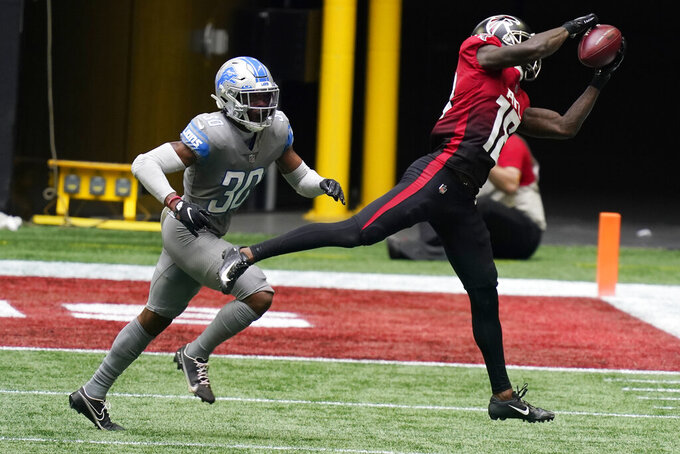 Atlanta Falcons wide receiver Calvin Ridley (18) makes the catch against Detroit Lions cornerback Jeff Okudah (30) during the second half of an NFL football game, Sunday, Oct. 25, 2020, in Atlanta. (AP Photo/Brynn Anderson)