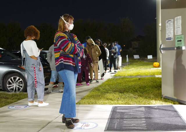 Aubrey Calaway, 23, waits to vote outside Victory Houston polling station in Houston early Friday, Oct. 30, 2020. The location was one of the Harris County's 24-hour locations. ( Elizabeth Conley/Houston Chronicle via AP)