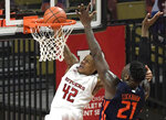 Rutgers guard Jacob Young (42) attempts to dunk the ball over Illinois center Kofi Cockburn (21) during the first half of an NCAA college basketball game Sunday, Dec. 20, 2020, in Piscataway, N.J. (AP Photo/Bill Kostroun)