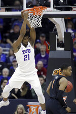 TCU's Kevin Samuel gets past Oklahoma State's Curtis Jones for adunk during the first half of an NCAA college basketball game in the Big 12 men's tournament Wednesday, March 13, 2019, in Kansas City, Mo. (AP Photo/Charlie Riedel)